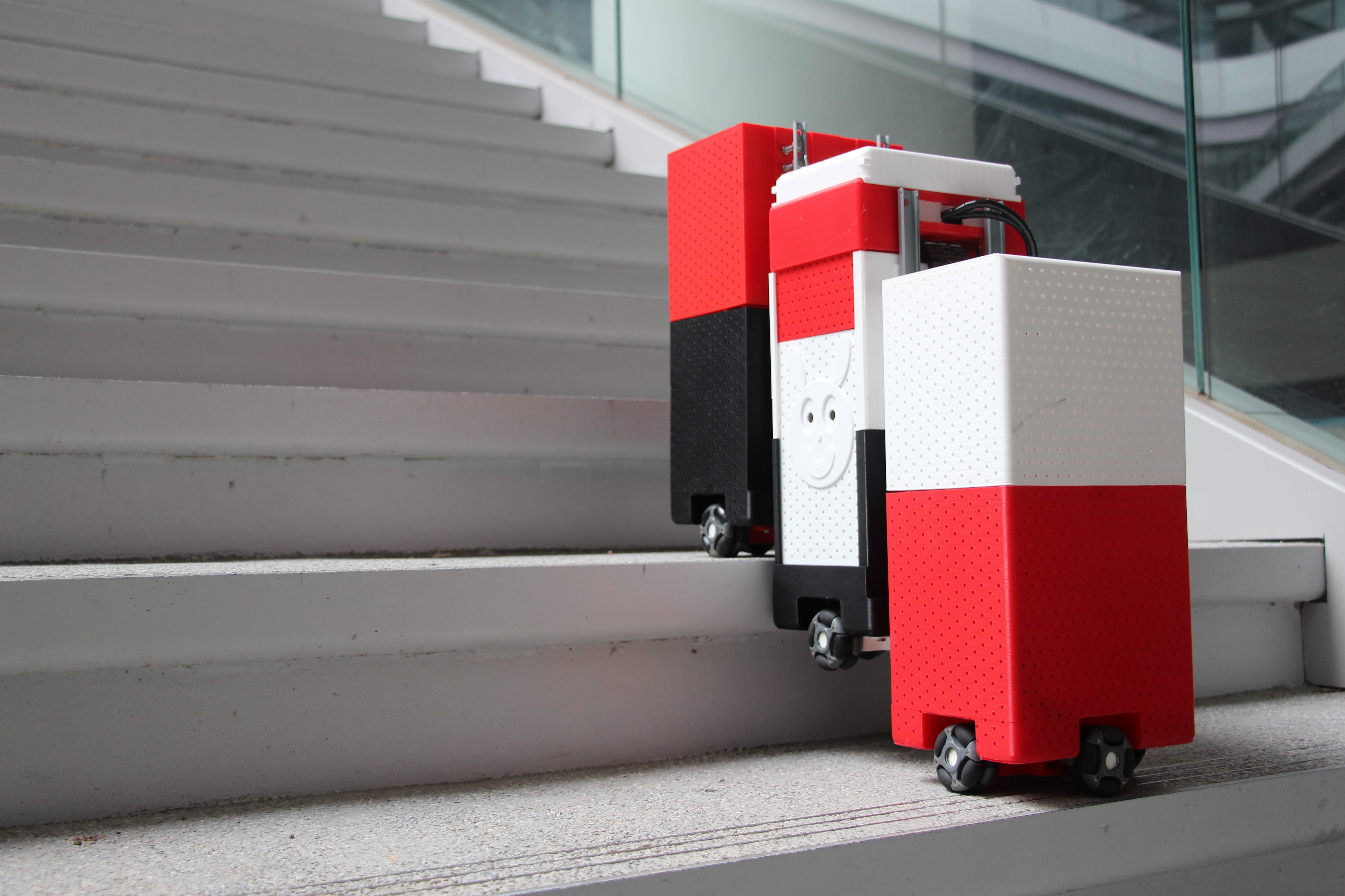 sTetro: A Modular Reconfigurable Staircase Cleaning Robot